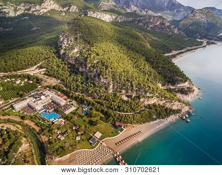 Aerial View On The Coastline, Mountains, Road, Tunel And Hotels, In Vicinities Of Kemer And Settleme