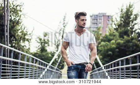 Handsome Young Man In White T-shirt Outdoor In City Setting