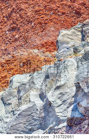 Volcanic Caldera Mixed Rocky Limestone Surface In One Of Santorini Beaches.red And White Bedrock. Ve