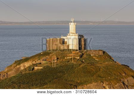 Mumbles Lighthouse The Iconic Landmark That Is Mumbles Lighthouse On The Gower Peninsula In Swansea,