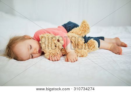 Adorable Baby Girl Sleeping With Her Favorite Toy. Little Child Having A Day Nap And Hugging A Teddy