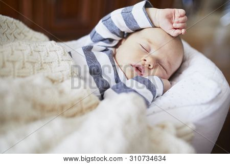 Adorable Baby Girl Sleeping In The Crib. Little Child Having A Day Nap In Cot. Infant Kid Resting In