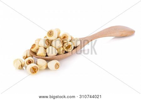 Dried Lotus Seeds On Wooden Spoon With White Background