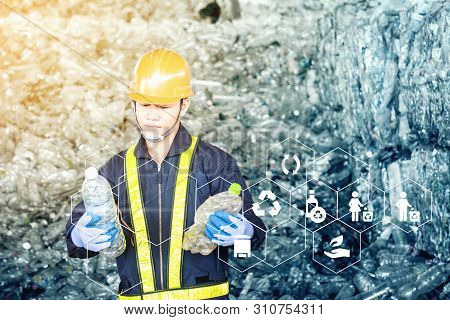Portrait Of Asian Industrial Engineer Workers With A Pile Of Plastic Bottles At The Factory For Proc