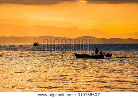 Thailand Sea In Twilight Time With Silhouette Ship And Fisherman In The Sea