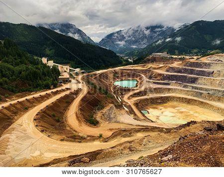 Open Cast Mining Erzberg, Austria, Landscape Of Winding Roads For Mining