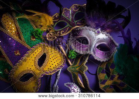 Mardi Gras masks on a dark background poster