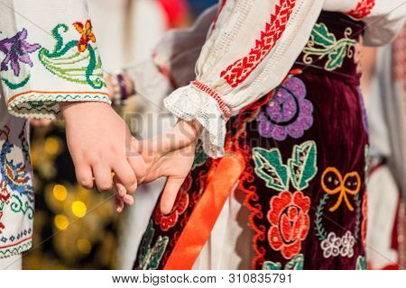 Close Up Of Hands Of Young Romanian Dancers Perform A Folk Dance In Traditional Folkloric Costume. F