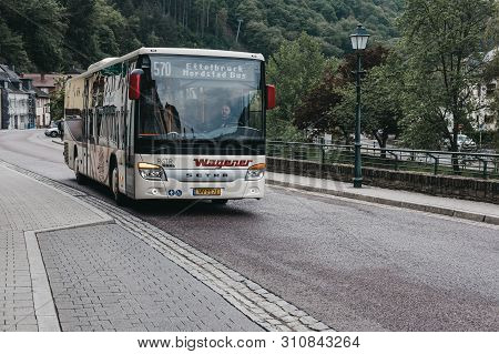 Vianden, Luxembourg - May 18, 2019: Local Bus On A Road In Vianden, Town In Luxembourgs Ardennes Reg