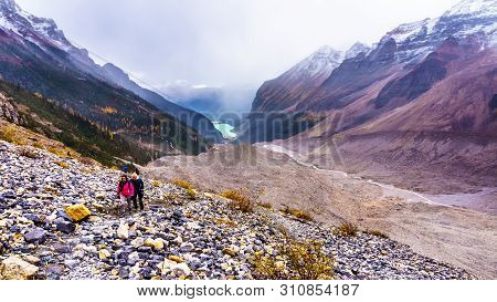 Senior Women Hiking On The Moraines Of The Victoria Glacier From The Plain Of Six Glaciers Teahouse