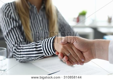 Focus On Smart Colleagues Shaking Hands In Modern Office And Reached Consensus In Solving Problem On