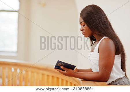 African American Woman Praying In The Church. Believers Meditates In The Cathedral And Spiritual Tim