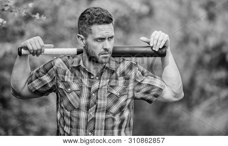 Confident In His Strength. Bully Guy In Nature With Cudgel. Wild Energy. Power And Strength. Feel My