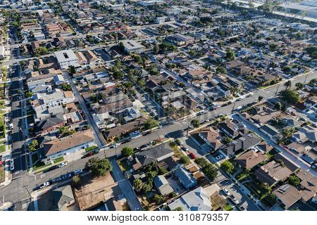 Afternoon aerial view of residential streets and buildings in the south bay area of Los Angeles County, California.