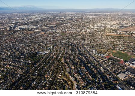 Afternoon aerial view of sprawling residential areas in the south bay area of Los Angeles County, California.