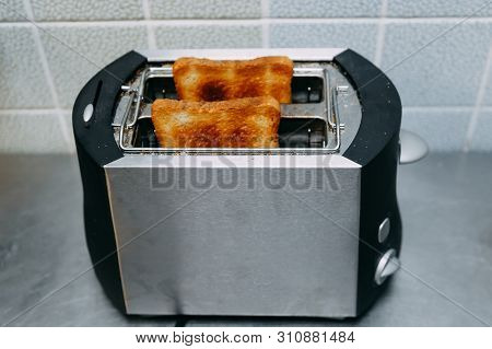 Healthy Fashion Food Of Breakfast. Toast In A Toaster. Toaster With Tasty Breakfast Toasts On The Ta