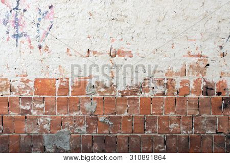 Red Brick Blocks Grungy Old Wall Covered Halfway By Grey Cement Stucco Material