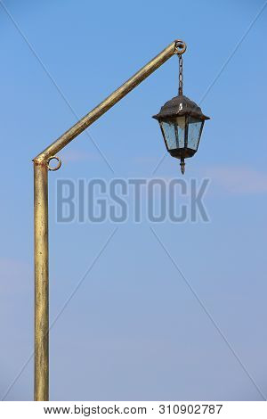 Gilded Old Vintage Street Lantern Isolated On Blue Sky With Copy Space For Text