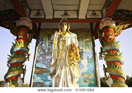 The beautiful golden Guan Yin statue at Khoksamrong shrine of Thailand is worth for salutation. poster