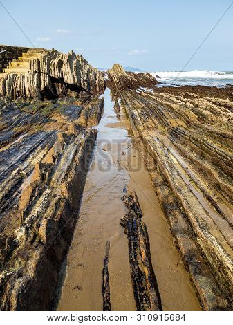 The Itzurum Flysch In Zumaia - Basque Country. Flysch Is A Sequence Of Sedimentary Rock Layers That
