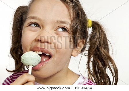 Close-up of little girl with a lollipop, isolated on white background