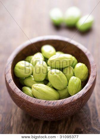 close up of bowl of petai beans poster
