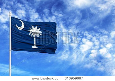 National Flag State Of South Carolina On A Flagpole In Front Of Blue Sky