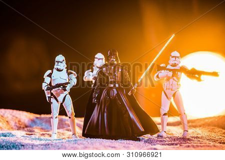 Kyiv, Ukraine - May 25, 2019: White Imperial Stormtroopers With Guns And Darth Vader With Lightsaber