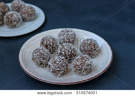 Curd Balls With Coconut Shavings And Chocolate Chip Cookies Re Located On A Dark Background, Horizon