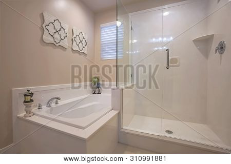 Bathroom Interior With A Polished Built In Bathtub And Shower Stall
