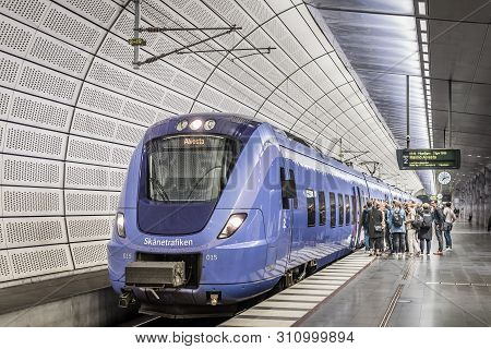 People Embark A Train At The Underground Station Triangeln In Malmo, May 21, 2019