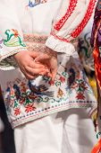 Close up s of young Romanian dancers perform a folk dance in traditional folkloric costume. Folklore of Romania poster