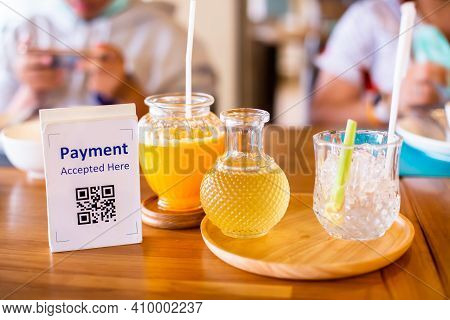 Selective Focus To Payment Qr Code Tag With Lemongrass Juice And Orange Juice