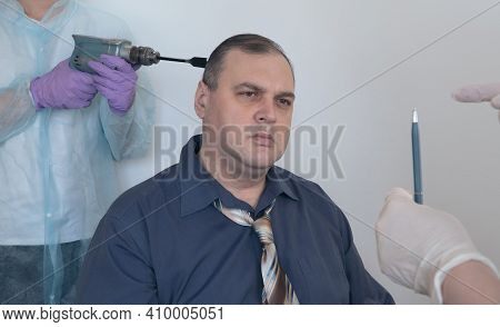 Patient In A Hypnosis Session. Man Is Put Into A Trance By The Actions Of The Hypnotist.  Concept Of