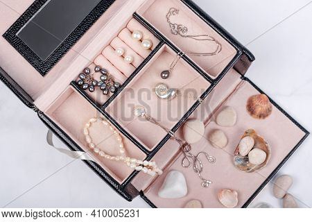 Sea Jewelry Collection In Jewelry Box On Light Marble Background With Seashells And Pebbles. Pearl P
