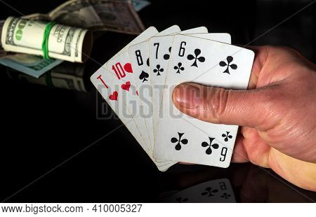 Poker Cards With A High Card Combination. Close Up Of A Gambler Hand Is Holding Playing Cards In Cas