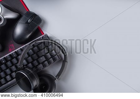 Gaming And Gamer Devices Concept. Gamer Work Table Space Background, Top View. Keyboard, Mouse, Game