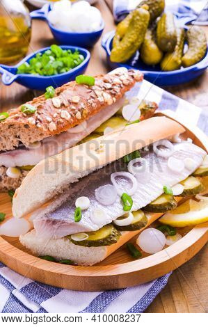 Dutch Herring. Toast With Dutch Herring, Onions, Pickles. Traditional Rustic Appetizer With Seafood.
