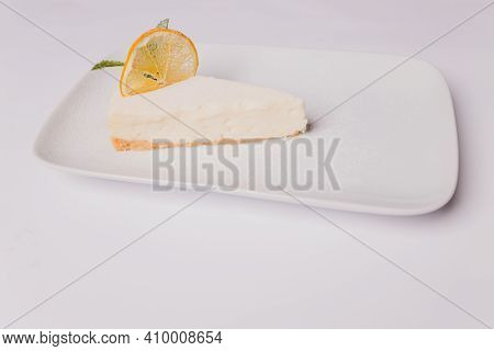 Plain Cheesecake On An Isolated White Background With Clipping Path.