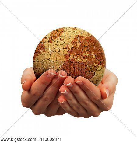 Parched planet earth in hands isolated on a white background. Global warming or change climate concept. Environmental problems.