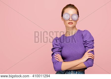 Young Woman In Purple Blouse And Onion Rings Eyeglasses Isolated On Pink, Surrealism Concept