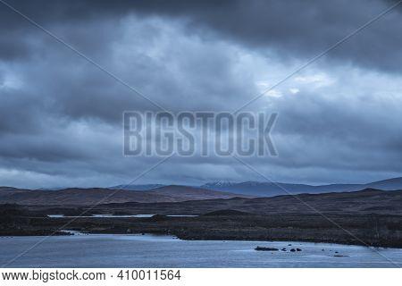 Epic Landscape Image Of Loch Ba On Rannoch Moor In Scottish Highlands On A Winter Morning