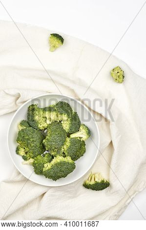 Organic And Healthy Broccoli On White Textile. Benefits Of Broccoli. Cooking At Home. Healthy Brocco