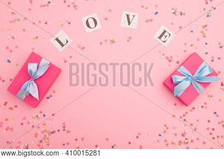 Composition With Love Inscription And Gifts On Pink Background. Flat Lay, Top View.