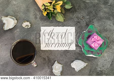 Gift Box On Resin Art Plate, Paper Card And Coffee Mug On Gray Background. Flat Lay, Top View