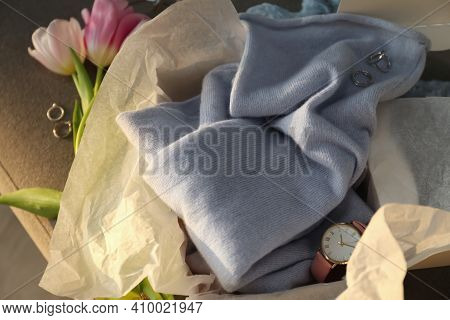 Soft Cashmere Sweater, Accessories And Tulips On Sofa