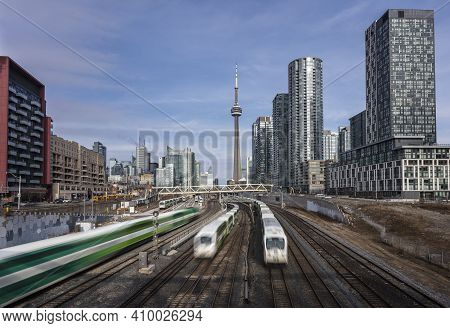 Toronto, Ontario, Canada - March 28 2018: Three Commuter Trains Passing Each Other In Downtown Toron