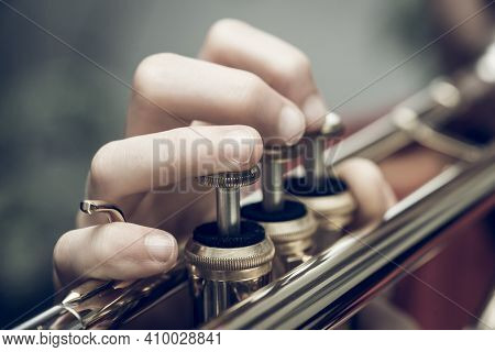 Close Up Of A Child Playing A Trumpet