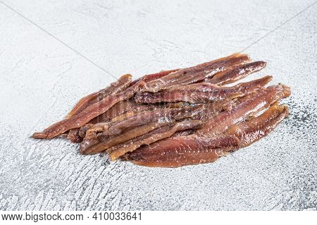 Canned Anchovies Fish Fillet In Olive Oil. White Background. Top View