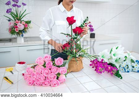 Arranging Artificial Flowers Decoration At Home, Young Woman Florist Work Making Organizing Diy Arti